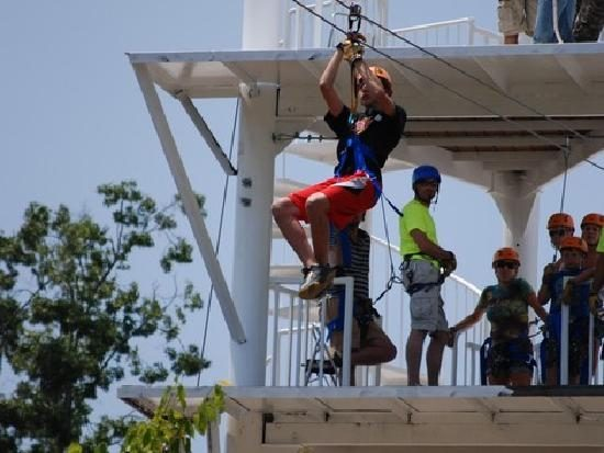 Stepping off the platform of Adventure Ziplines