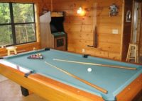 Play a game of pool in your Alpine Chalet cabin in the Smokies.