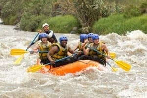 Group whitewater rafting during spring in the Smoky Mountains.