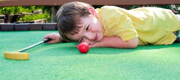 Little boy enjoying the best mini golf in Pigeon Forge and Gatlinburg.