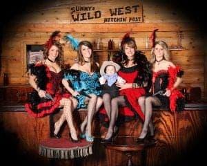 Women dressed as flapper saloon girls