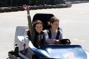 friends riding go karts