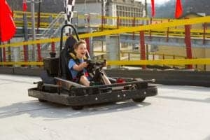 boy driving a go kart