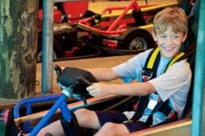 boy riding a go kart